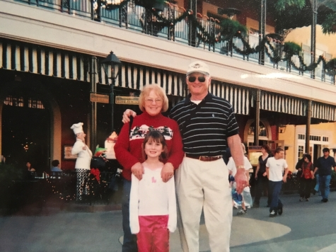 Author Hannah Shows as a child with her grandparents at Disneyland circa 2005