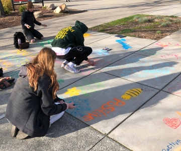 Students making chalk art