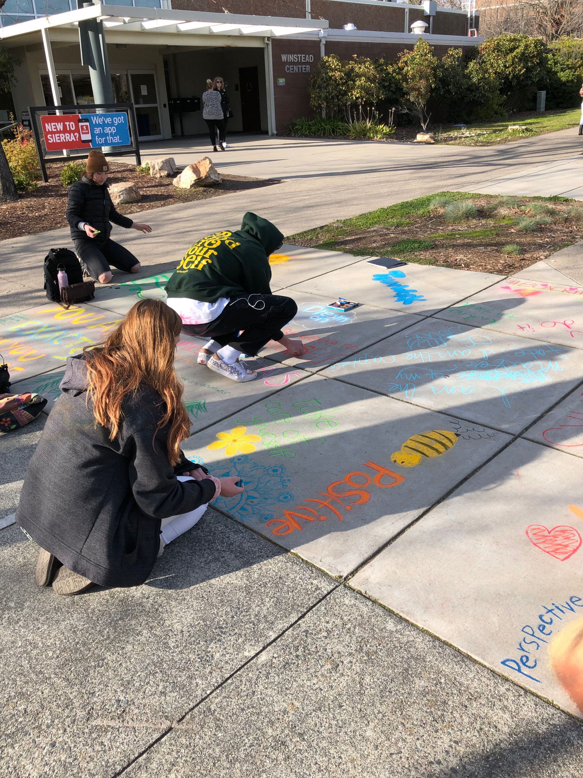 Students making chalk art