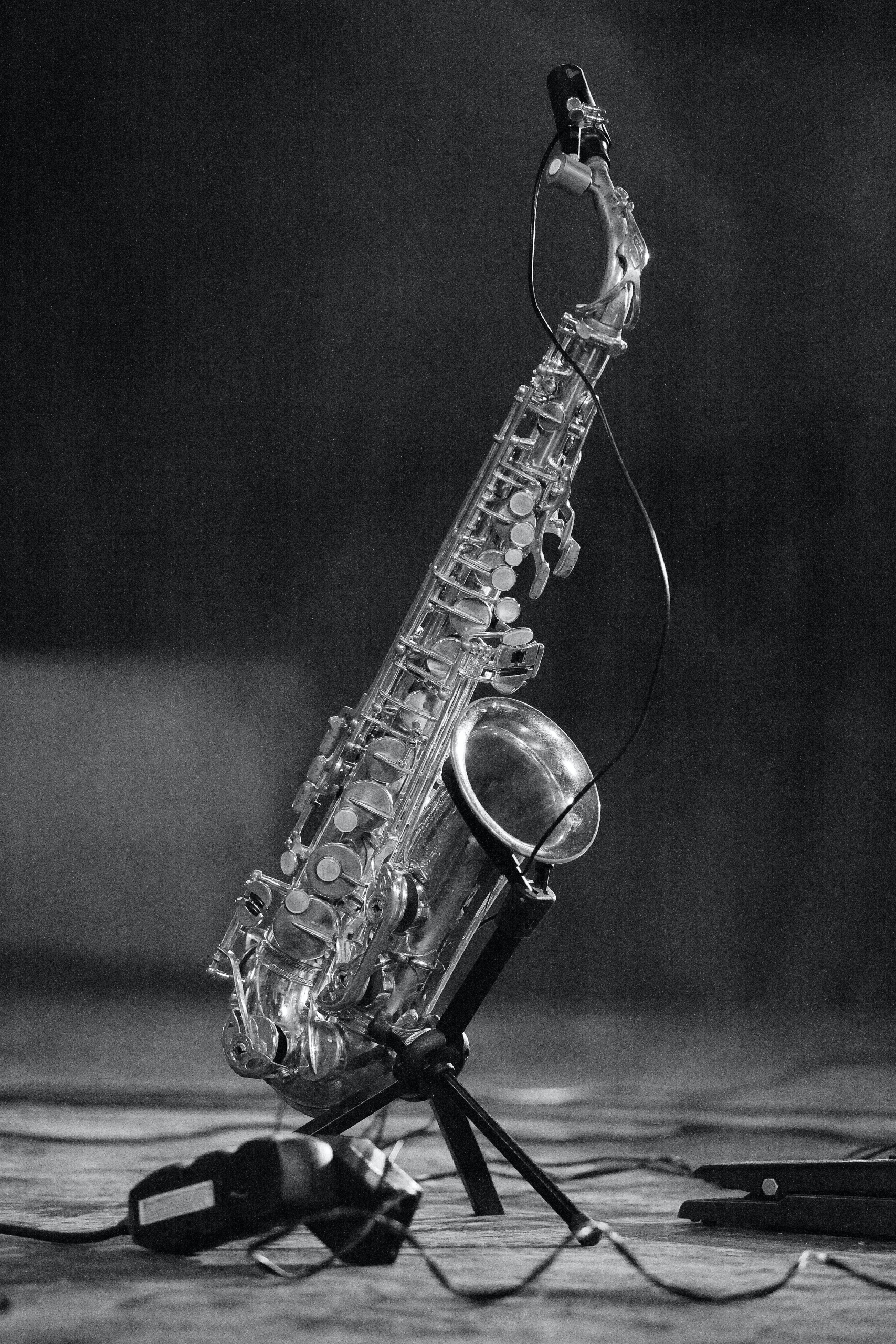 Saxophone in black and white photo on a stand on a stage