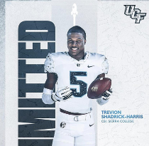 Trevion Harris posed with football and smiling