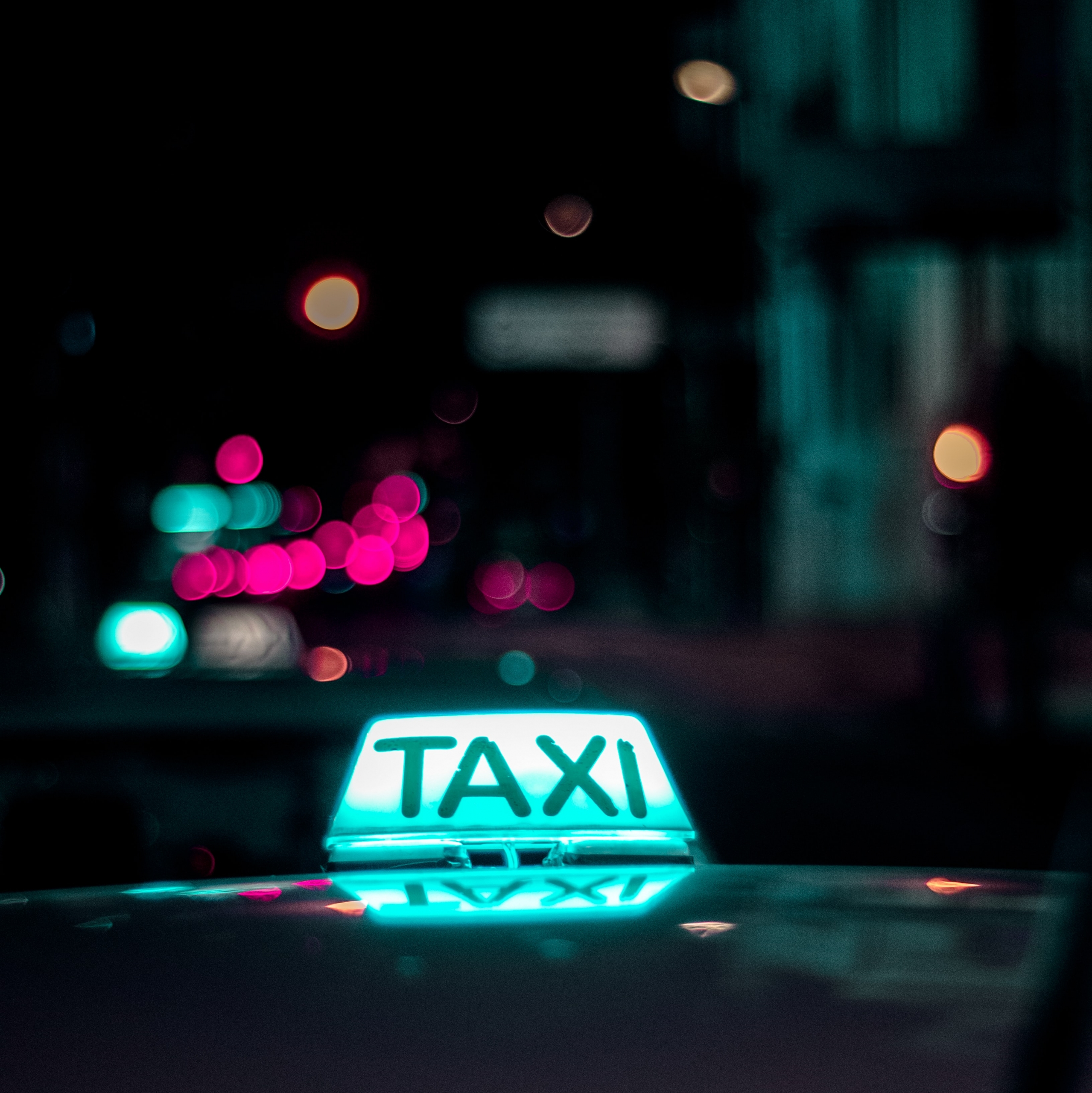 taxi in dark city with neon lights